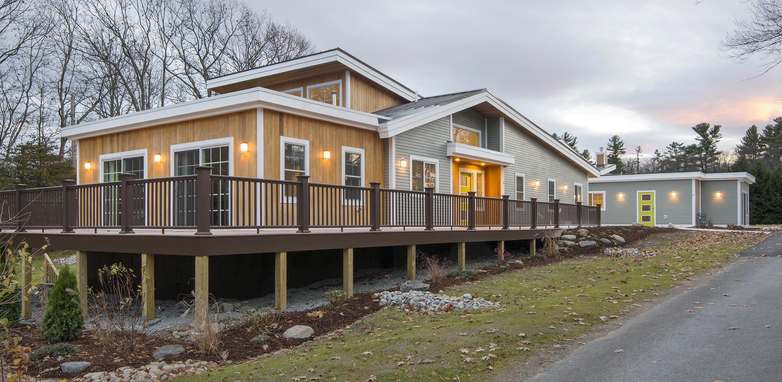 New construction of a sustainable 2-building, 9-unit group home in Carlisle, MA.