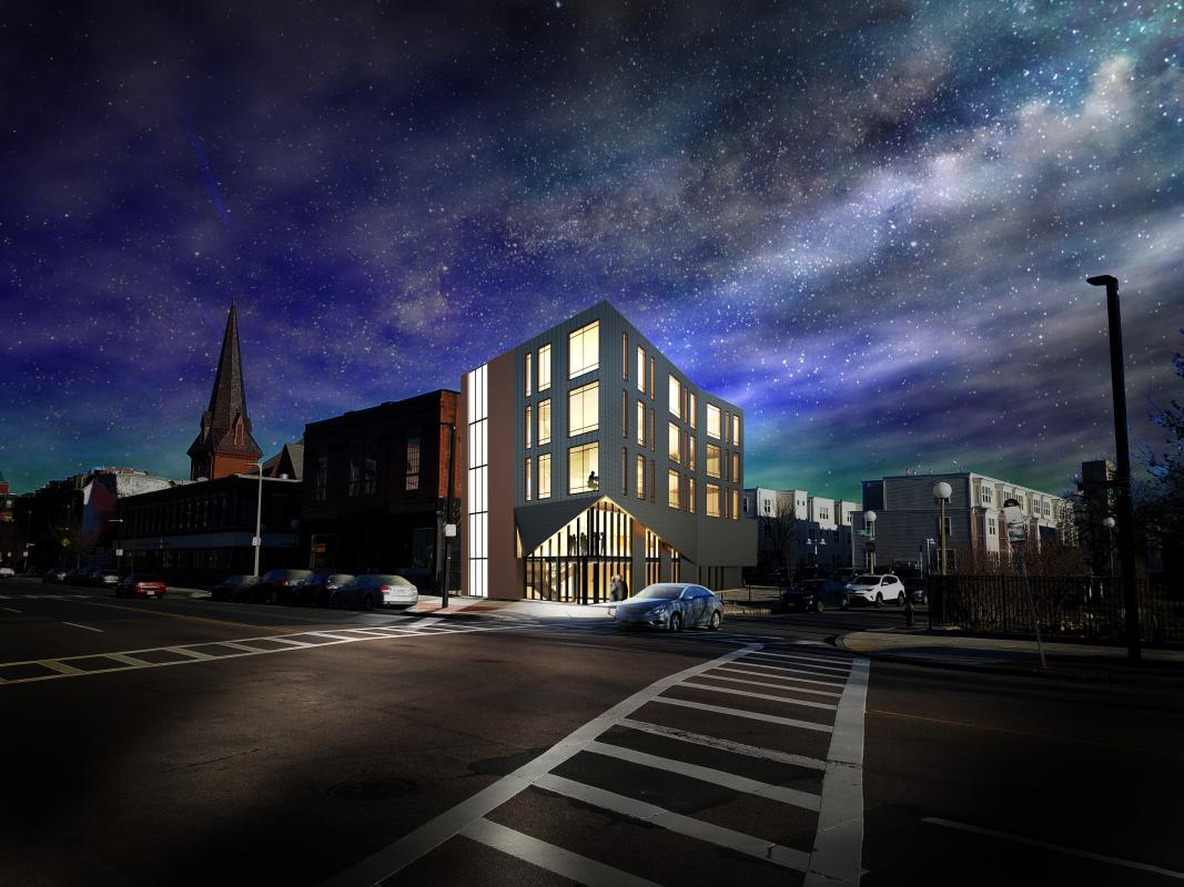 Rendering of nighttime exterior view at street corner