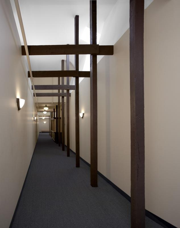 Interior hallway with clerestory windows and exposed posts and beams