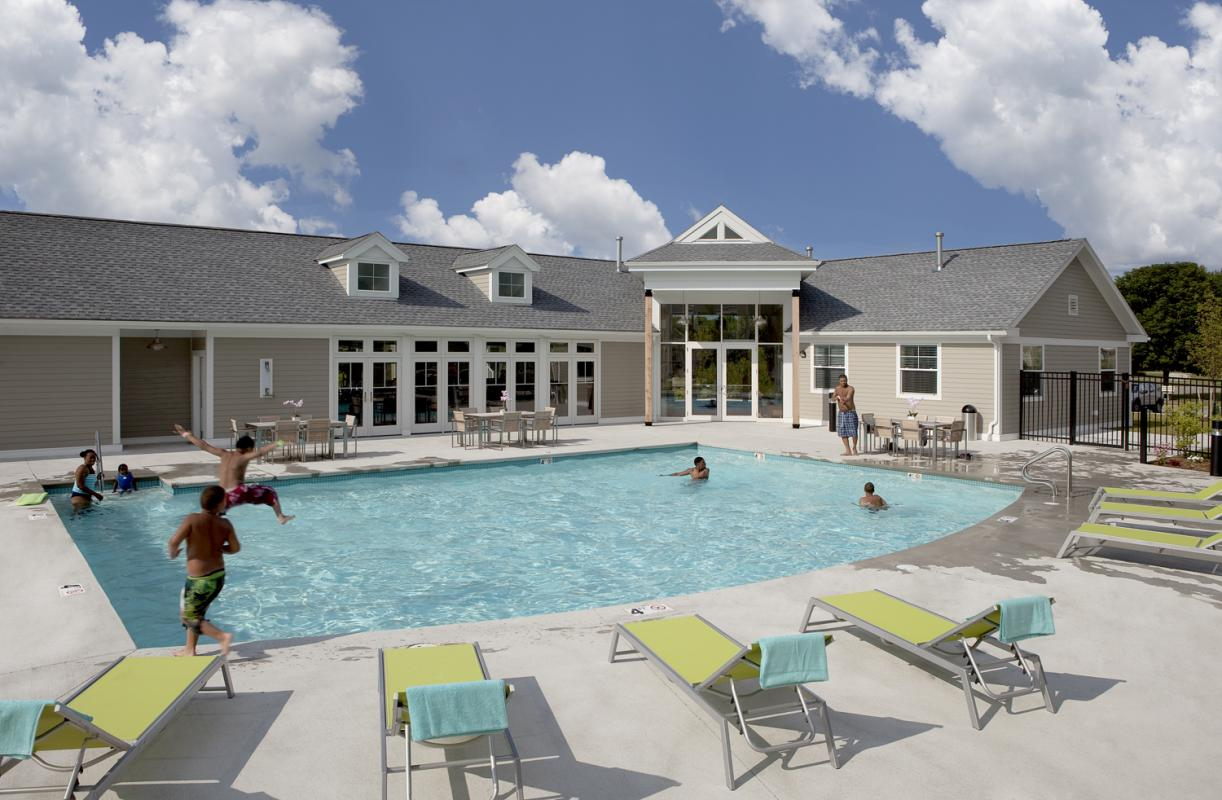 Poolside view with clubhouse facing pool