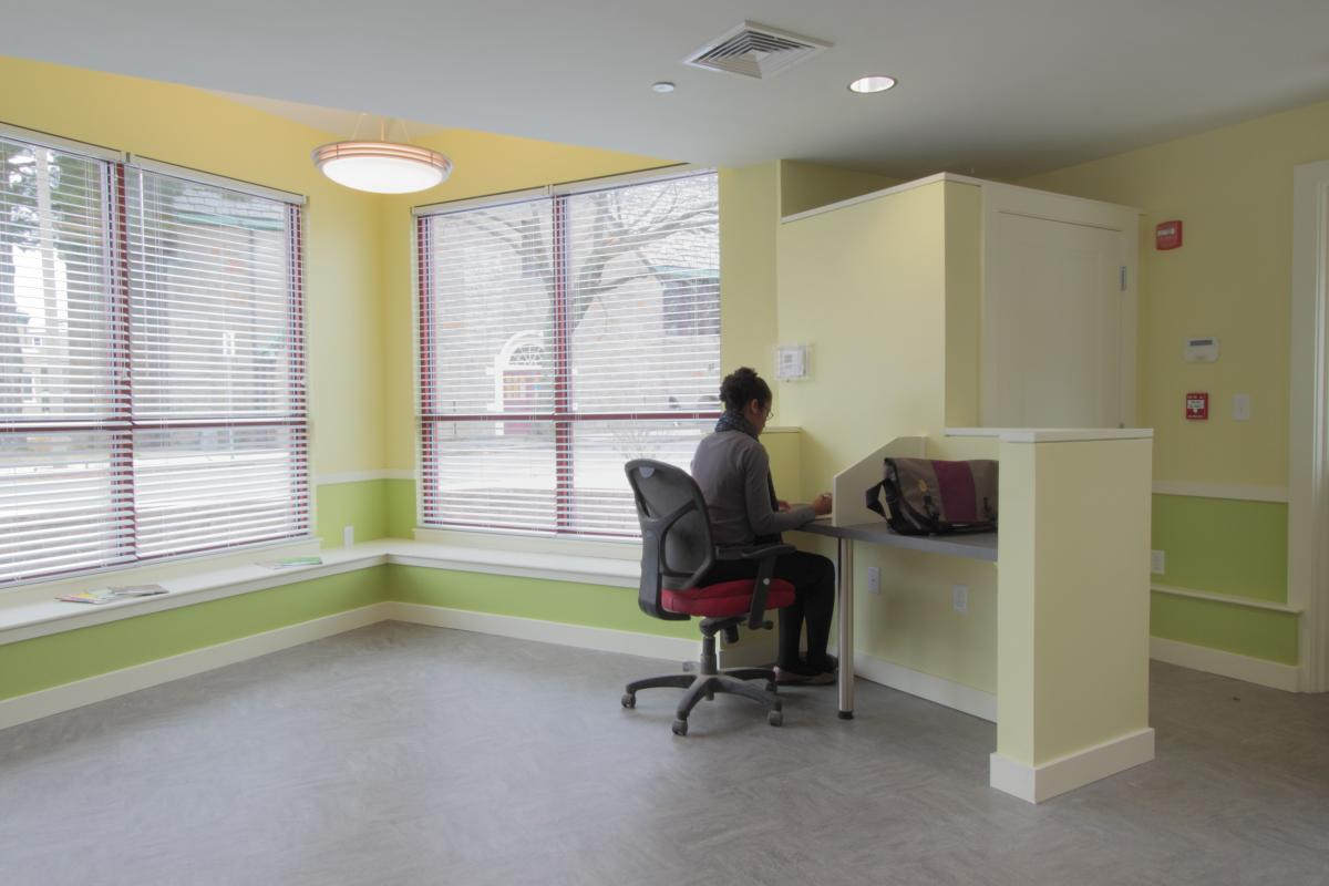 Interior community space with desk stations