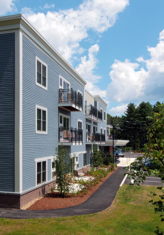 Rear exterior view with unit patios and balconies