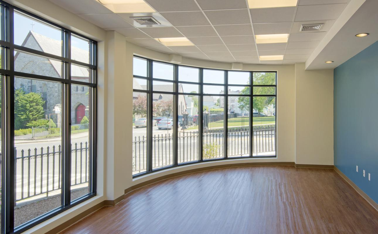 Community room interior with window walls