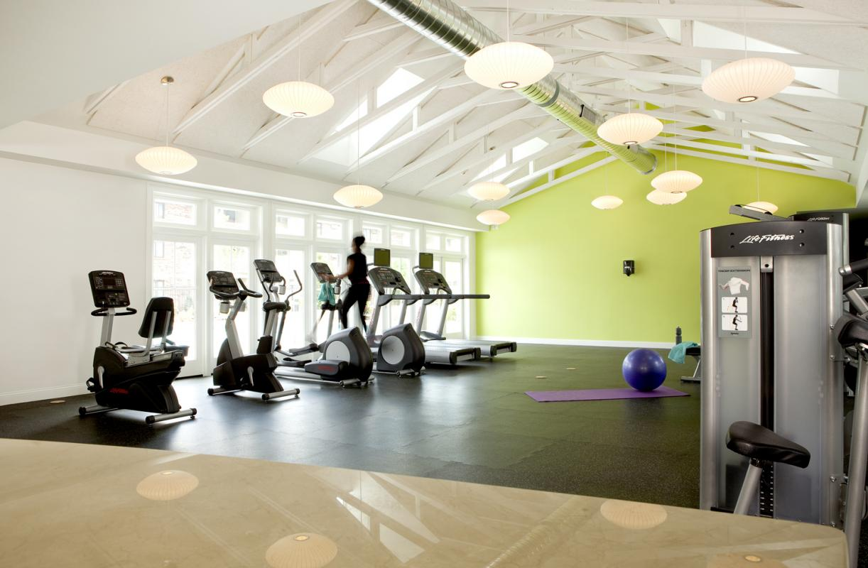 Exercise room with vaulted ceiling