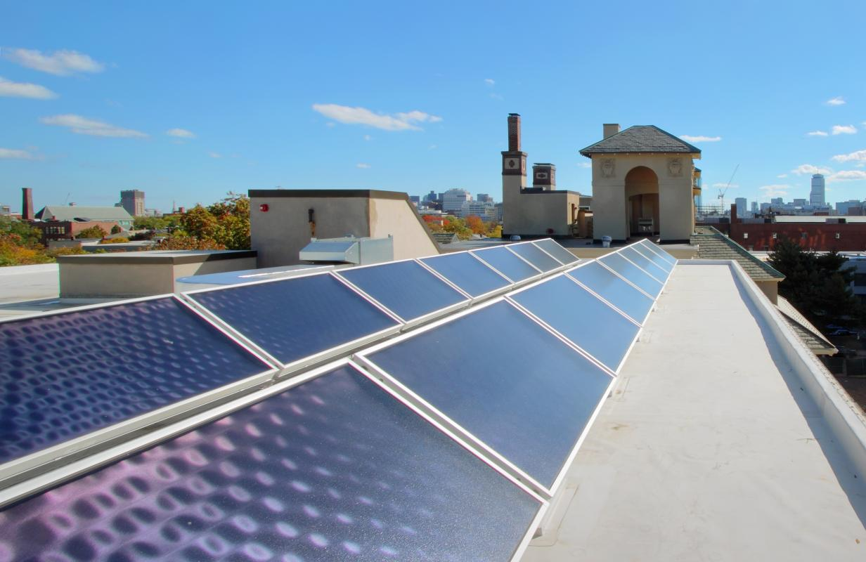 Roof with solar panels and skyline view of Boston