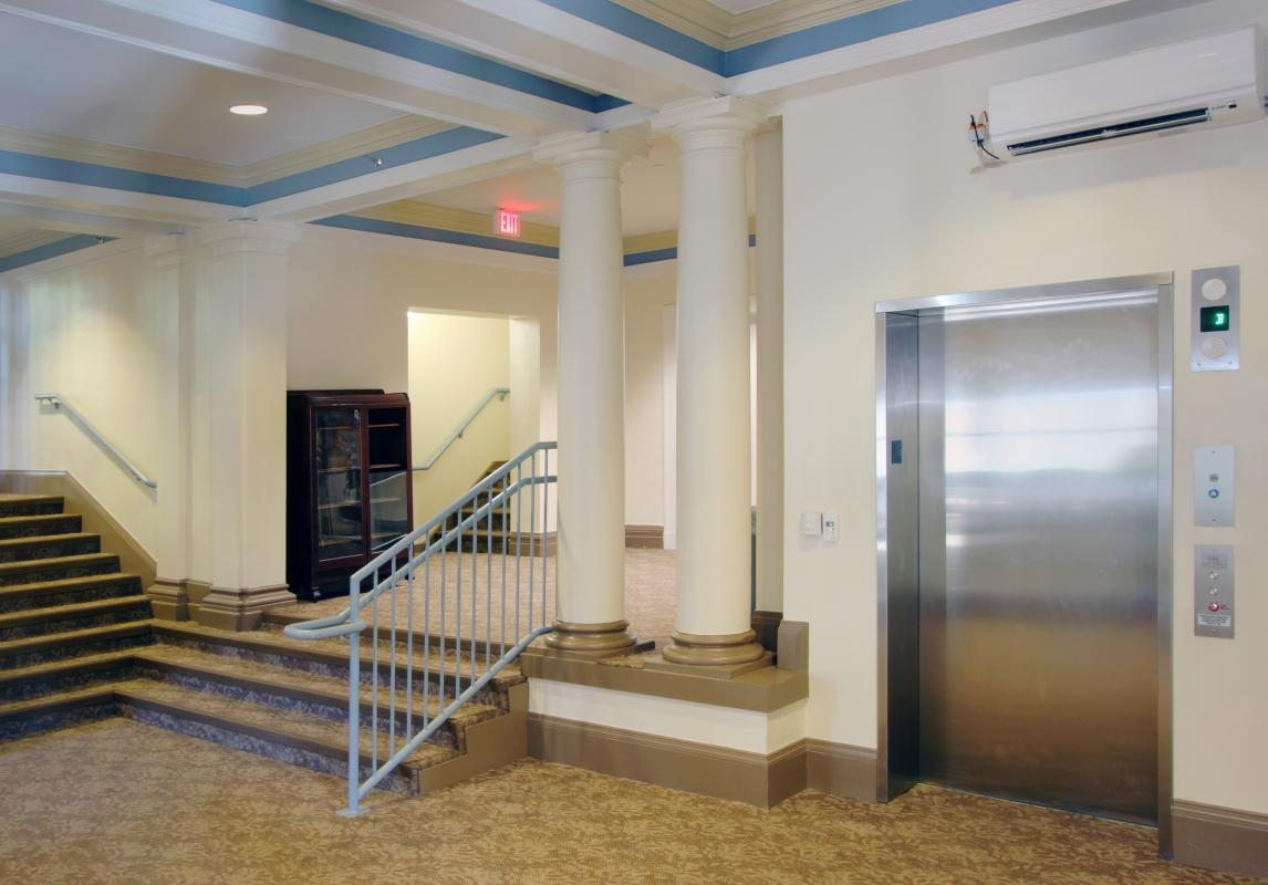 Lobby interior with stairways and elevator