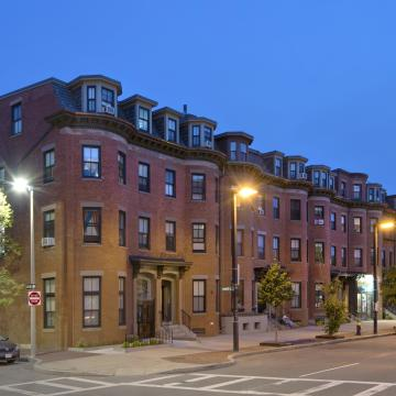 Row of buildings from street corner at twilight
